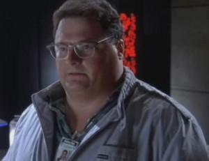 Dennis T. Nedry, développeur et héros techniquque dans le film Jurassic Park.